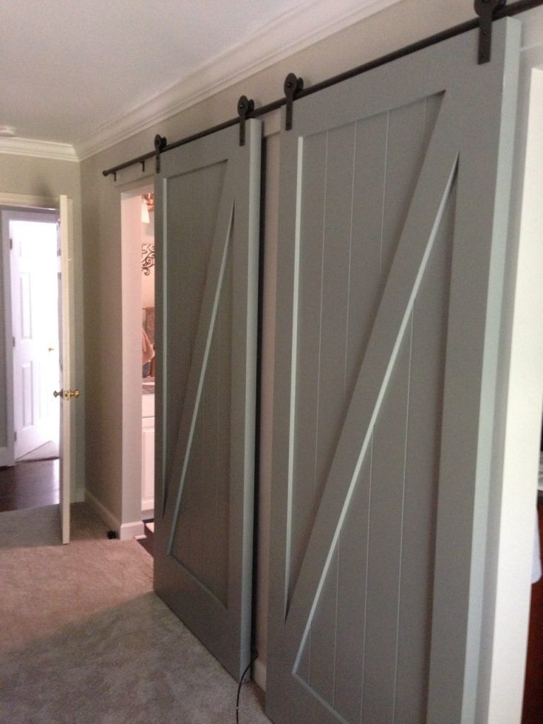 Whole Home Renovations Contractor with Barn Doors to Bathroom